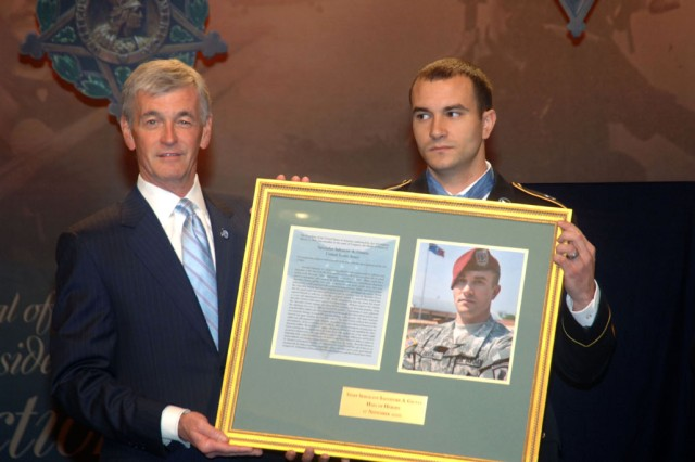 The Secretary of the Army, the Honorable John McHugh, presents a photo and citation of the Medal of Honor to Staff Sergeant Salvatore A. Giunta during the Medal of Honor Hall of Heroes Induction Ceremony at the Pentagon on November 17, 2010.