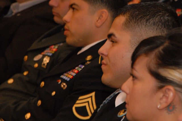 Members of 1st Platoon, Battle Company, 173rd Airborne Brigade Combat Team, including Staff Sgt. Erick Gallardo (second from right), the squad leader Staff Sgt. Salvatore Giunta helped up during the Korengal battle, listen as Giunta speaks during the Pentagon Hall of Heroes ceremony Nov. 17.