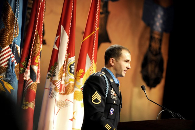 Medal of Honor recipient Army Staff Sgt. Salvatore Giunta thanks his teammates from Company B, 2nd Battalion, Airborne, 503rd Infantry Regiment and all those in the room that helped shape his life, during his induction ceremony into the Hall of Heroes at the Pentagon, Nov. 17, 2010.