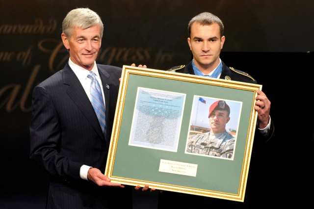 Secretary of the Army John McHugh presents a plaque to Medal of Honor recipient Army Staff Sgt. Salvatore Giunta during his induction ceremony into the Hall of Heroes at the Pentagon, Nov. 17, 2010.