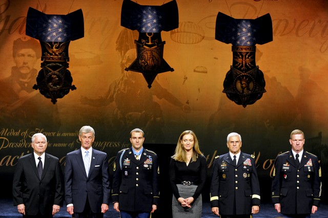 From left to right: Defense Secretary Robert M. Gates, Army Secretary John McHugh, Medal of Honor recipient Army Staff Sgt. Salvatore Giunta, his wife Jennifer Giunta, Army Chief of Staff Gen. George W. Casey Jr. and Sgt. Maj. of the Army Kenneth O. Preston listen to Giunta's citation during his induction ceremony into the Hall of Heroes at the Pentagon, Nov. 17, 2010.