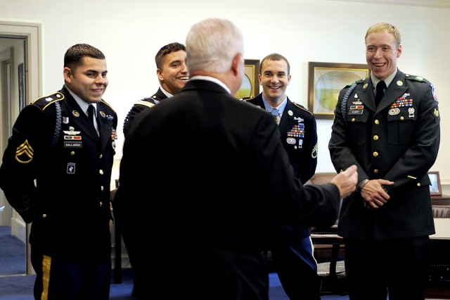 Defense Secretary Robert M. Gates shares a laugh with Medal of Honor recipient Army Staff Sgt. Salvatore Giunta, second from right, and members of Company B, 2nd Battalion, Airborne, 503rd Infantry Regiment, in Gates' office at the Pentagon, Nov. 17, 2010.