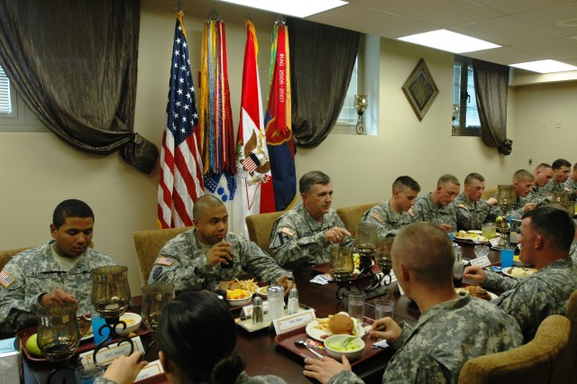 "Soldiers such as Sgt. Billy Reniva (far left), Headquarters and Headquarters Company, 25th Combat Aviation Brigade, enjoy a lunch time discussion with Gen. Peter W. Chiarelli, Vice Chief of Staff of the Army, at Bronco dining facility on Schofield Barracks, Nov. 15. Fourteen 25th CAB Soldiers joined other Soldiers from across the Tropic Lightning Division, as Gen. Chiarelli discussed topics such as behavioral health issues, traumatic brain injury and the ""Don't Ask, Don't Tell"" Policy."