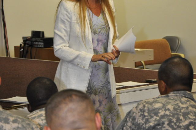 Beverly Tate, the CAB commander's wife, addresses the Soldiers about utilizing services provided by the Family Readiness Group, Oct 29.