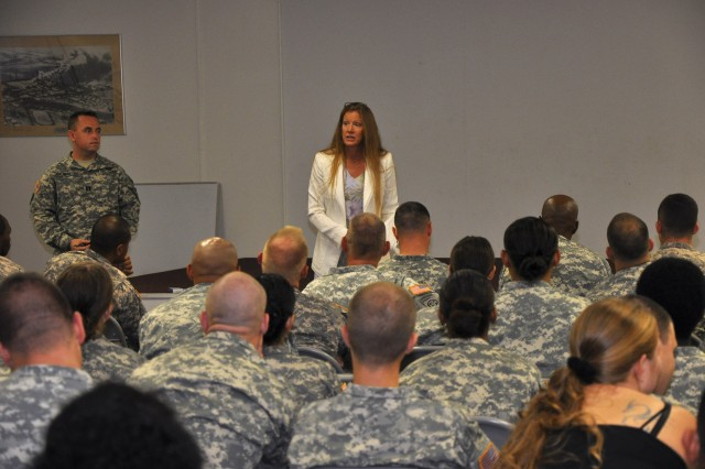 BodyAt a family readiness meeting in 25th ID Combat Aviation Brigade's Multifunctional Room of Excellence on Wheeler Army Airfield, Beverly Tate, the CAB commander's wife, addresses the Soldiers about utilizing services provided by the Family Readiness Group, Oct 29.