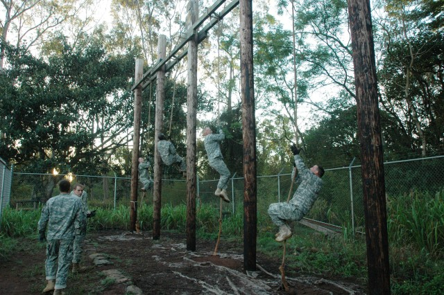 Soldiers from Headquarters and Headquarters Company, 25th Combat Aviation Brigade, compete on an obstacle course during physical fitness training at Schofield Barracks, Nov. 2.