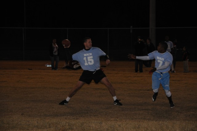 MEDDAC quarterback Christian Nelson goes back for a pass during his team's 27-20 loss to the Savannah Marines in the 3rd ID Intramural Flag Football Championship at Hunter, Nov. 8