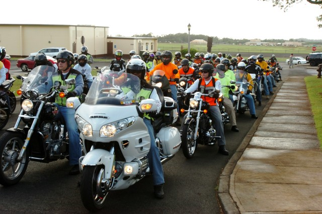 Motorcycle riders from the 25th Combat Aviation Brigade ready their motorcycles before embarking on a 25th Infantry Division Veterans' Day ride from Wheeler Army Airfield, Nov. 10.