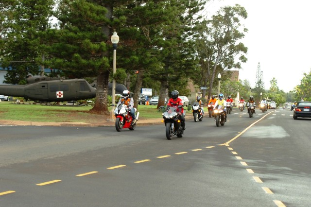 Soldiers of the 25th Combat Aviation Brigade take-off on their motorcycles, from Wheeler Army Airfield, to join other 25th Infantry Division (ID) riders during the 25th ID Veterans' Day Motorcycle Ride from Schofield Barracks, Nov. 10.