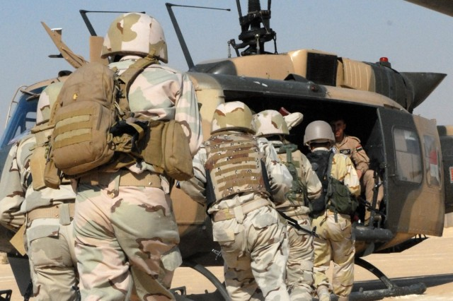 Iraqi Army Soldiers with the 7th IA Division practice loading a UH-60 Black Hawk helicopter Nov. 11 as part of an air assault operations class taught by IA aviation personnel and Soldiers with 4th Advise and Assist Brigade, 3rd Infantry Division, United States Division - Center, at Camp Mejid, Iraq.