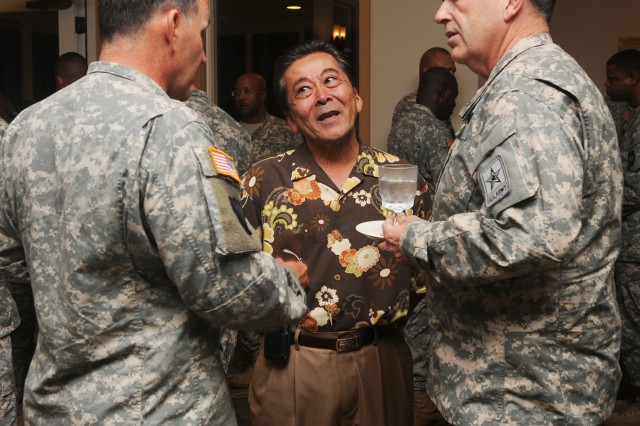 Lt. Gen. Benjamin R. Mixon, U.S. Army Pacific commander, Herb Morikawa, USARPAC deputy G8, and Army Vice Chief of Staff Gen. Peter W. Chiarelli talk at the Hale Ikena Club, Fort Shafter, Hawaii. Chiarelli visited Oahu Nov. 16 and met with 25th Infantry Division Soldiers and Wounded Warriors, and toured the Makua training facility on Schofield Barracks. (U.S. Army photo by B.J. Weiner)