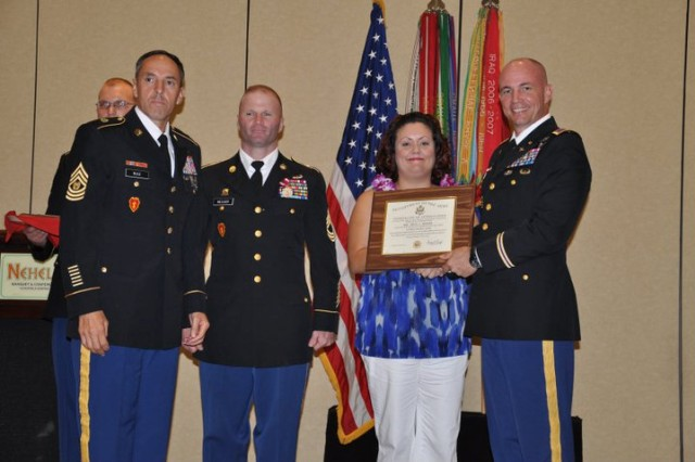 First Sgt. Joseph B. Messier, 2nd Brigade Combat Team (second from left), poses for a photo with Command Sgt. Maj. Jesus Ruiz, command sergeant major, 25th Combat Aviation Brigade (left); his wife Tricia; and Col. Frank Tate, commander, 25th CAB, during the 25th Infantry Division Quarterly Retirement Ceremony on Schofield Barracks, Hawaii, Nov. 17. Messier retires from Active duty with over 23 years of service.