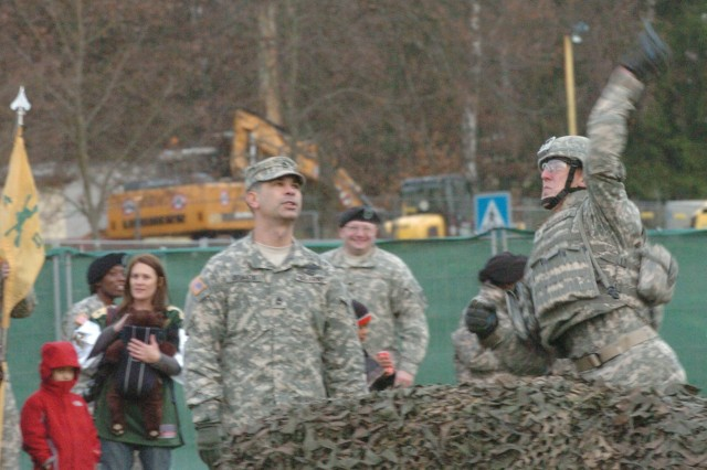 """Spc. Thomas McPherson, a native of Satsuma, Fla., and a wheeled vehicle mechanic for the 23rd Ordnance Company, throws a grenade during the ESPN Veteran's Day Warrior Challenge grenade toss event. The 18th CSSB """"Warhammer"""" team took part in the ESPN Veterans Day event at the Grafenwoehr Training Area, competing against five other teams in various events. The 18th CSSB placed second out of six teams."""