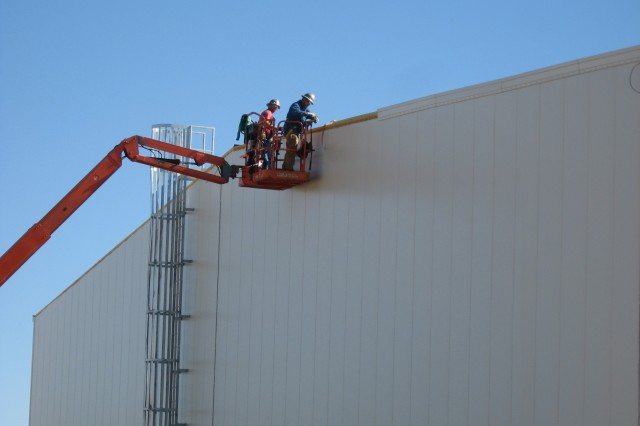Blue Grass Chemical Agent-Destruction Pilot Plant workers install roof trim on the Utility Building.
