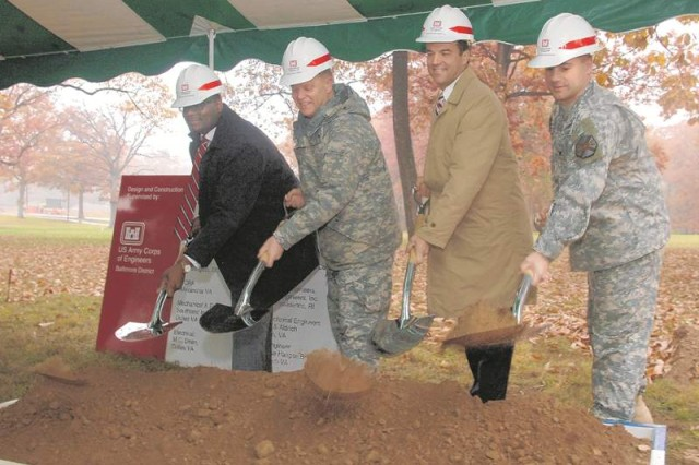 Using ceremonial shovels and hard hats, Tate, DiNapoli, McNeil, and Fort Belvoir Garrison Commander Col. John Strycula broke ground on the site.