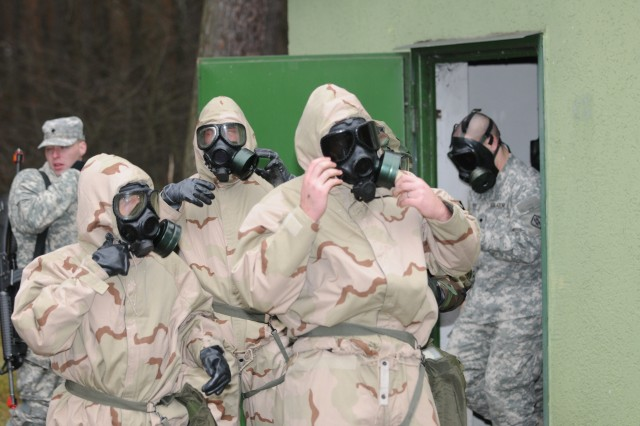 MANNHEIM, Germany (Nov. 17, 2010) -- Soldiers with the 181st Signal Company exit a gas chamber after a gas mask canister exchange during Chemical, Biological, Radiological and Nuclear training at the Local Training Area. Soldiers with 5th Signal Command's 43rd Signal Battalion conducted a three-day field exercise at the LTA using real-world scenarios to train Warrior Task skills. (Photo by Jonathon M. Gray, 5th Signal Command)