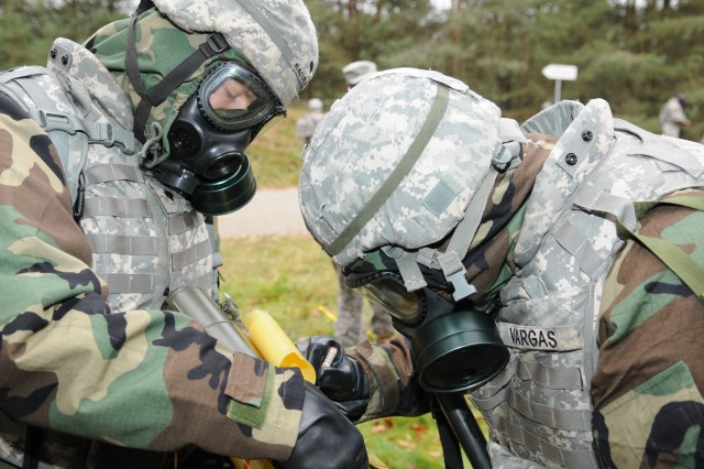 MANNHEIM, Germany (Nov. 17, 2010) - Spc. Anthony Basurto (left) and Pfc. Harvey Vargas (right), 181st Signal Company, prepare a chemical contamination sign to mark a contaminated area during Chemical, Biological, Radiological and Nuclear training at the Local Training Area. Soldiers with 5th Signal Command's 43rd Signal Battalion conducted a three-day field exercise at the LTA using real-world scenarios to train Warrior Task skills. (Photo by Jonathon M. Gray, 5th Signal Command)