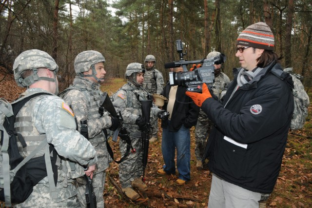 MANNHEIM, Germany (Nov. 16, 2010) -- 1st Lt. Robert Townsend, 181st Signal Company, talks with Kristopher Joseph, 5th Signal Command Public Affairs Office, during simulated humanitarian aid and react to the media training at the Local Training Area. Soldiers with 5th Signal Command's 43rd Signal Battalion conducted a three-day field exercise at the LTA using real-world scenarios to train Warrior Task skills. (Photo by Jonathon M. Gray, 5th Signal Command)