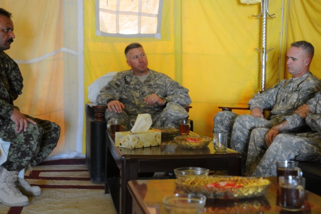 Col. Daniel Williams, the 4th CAB commander, Command Sgt. Maj. Donald Rose, the senior noncommissioned officer of 4th CAB and the Afghan National Army unit commander, General Asharf speak to one another about potential possibilities for the ANA in the future.