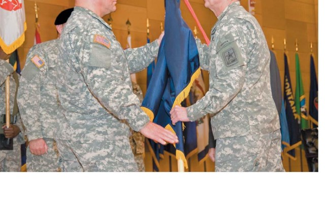 Lt. Gen. William Troy (right), director of the Army staff and host of the ceremony, passes the U.S. Army Test and Evaluation Command colors to Maj. Gen. Genaro Dellarocco, who assumes command of ATEC when Dr. James Streilein departs for an assignment in the Pentagon.