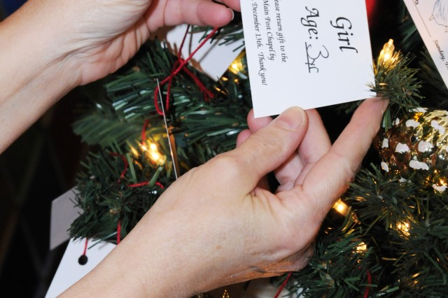Community members may donate Christmas gifts to needy military children this year through the Angel Tree project. Trees bearing tags with children's ages and genders on them are available at the Post Exchange and Main Post Chapel. Unwrapped gifts must be returned to the chapel by Dec. 14.