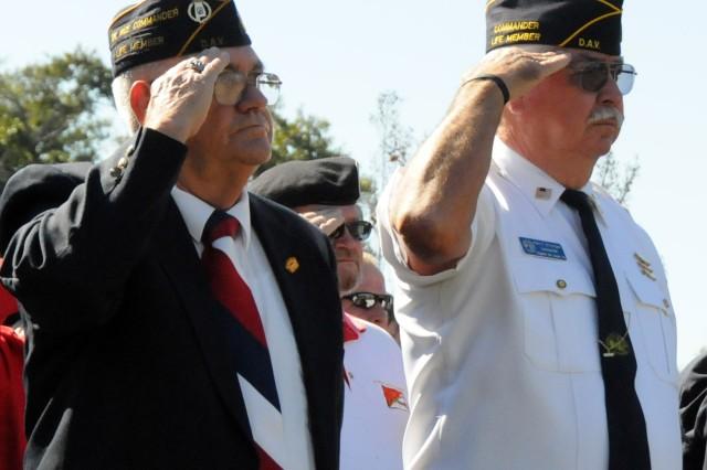 Retired Sgt. 1st Class William Bowman, DAV Ozark Chapter member, and Retired Master Sgt. Harry Grainger, DAV Ozark Chapter commander, salute the colors during the post's annual Veterans Day ceremony at Veterans Park Nov. 11.