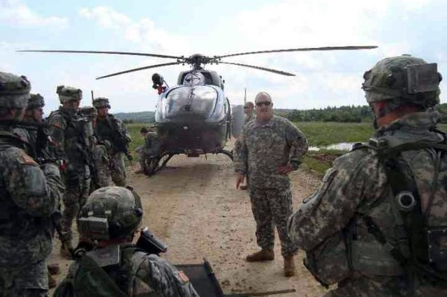 Members of the 121st Medical Company, Air Ambulance, of the District of Columbia National Guard prepare for a mission in Hohenfels, Germany. The unit conducted its first medical evacuation with the UH-72 Lakota helicopter in Germany on Aug. 10, 2010.