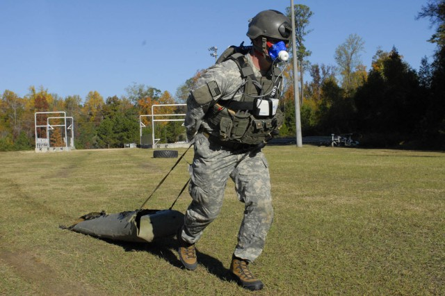 Sgt. John Rossmiller of the 75th Ranger Regiment drags a 185-pound pulling sled during an assessment Wednesday. He's seen wearing a Mobile VO2 Assessment Unit, which monitors oxygen efficiency proportionate to activity level.