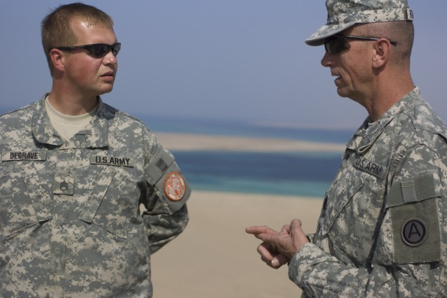 SHARM EL SHEIKH, Egypt - Command Sgt. Maj. John D. Fourhman, Third Army command sergeant major, speaks with Staff Sgt. Brad DeGrave, a cannon crewmember with A Company, 2nd Battalion, 123rd Field Artillery Regiment, Illinois Army National Guard, serving with Multi-National Force and Observers, atop Observation Post 31 at South Camp, in Sharm El Sheikh, Egypt, Nov. 16.  DeGrave, a native of Milan, Ill., and his Soldiers with Company A, rotate 21-day shifts at the observation point located above the Strait of Tiran to observe and report all vessels and aircraft movement through their area of operation. Third Army's top noncommissioned officer visited Soldiers at multiple observation posts during a three-day tour to see the full spectrum of Third Army operations and receive updates on current missions.   (Photo by Sgt. M. Benjamin Gable, 27th Public Affairs Detachment)