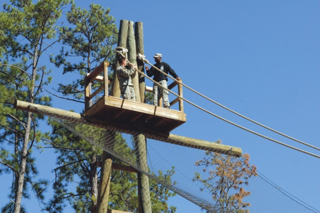 Staff Sgt. Tony Genovese prepares to slide down the Inverted Rope on Wednesday. The Inverted Rope is one of 26 obstacles in the obstacle course event.