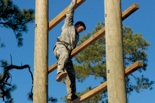 Staff Sgt. Tony Genovese of Illinois makes his way down the Confidence Climb obstacle.