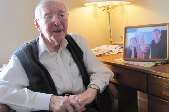 Dieter Grau, 97, sitting near a picture of his son, daughter and daughter-in-law, remembers the opportunities America provided the German scientists who brought rocket technology to the U.S. The German scientists went on to team with American engineers to use rocket technology developed during wartime as a vehicle for peacetime space exploration.