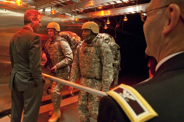 Senator Scott Brown of Massachusetts speaks with Soldiers walking on a treadmill in the Doriot Climatic Chamber during a Nov. 19 visit to the Natick Soldier Systems Center.