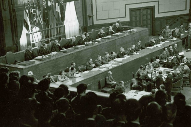 Tribunal judges seated at the bench in the War Ministry Building courtroom in Tokyo, Japan, during the arraignment of 28 major Japanese war criminals before the International War Crimes Tribunal for the Far East, in May 1946.  The 28 accused war criminals all pleaded not guilty.