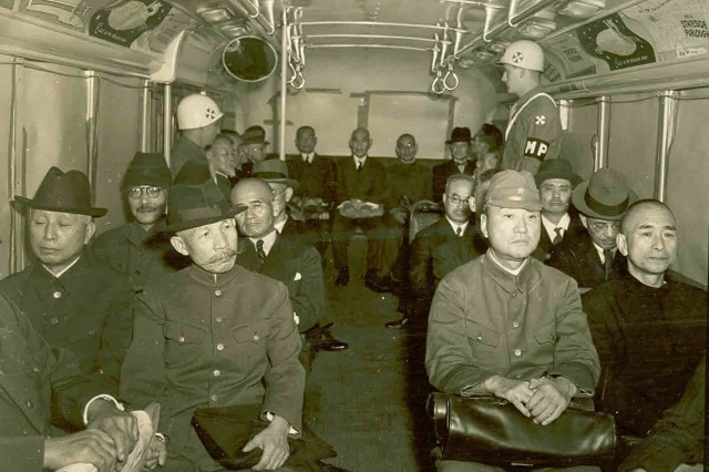 Japanese war criminals, including Hideki Tojo (second row, left, in glasses), on their way to be arraigned at the War Ministry Building in Tokyo, Japan, where the first session of the Tokyo Trials were held, in May 1946.
