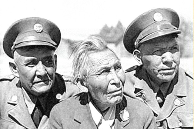 Army code talkers (left to right) Cpl. Jim Lane, Cpl. John Rope and Cpl. Kassey Y-32 pose for a photo at Fort Huachuca, Ariz., in 1942. Code talkers played a pivotal role in helping Allied Forces keep their communication secure during World War II.