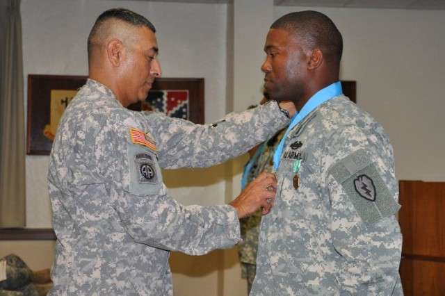 Sergeant 1st Class Omar Mosley, Company A, 2nd Battalion, 35th Infantry Regiment, 3rd Brigade Combat Team, 25th Infantry Division, receives Sgt. Audie Murphy Club Medallion from Command Sgt. Maj. Frank M. Leota, 25th Inf. Div. command Sgt. Maj. during the 25th Inf. Div. Sgt. Audie Murphy Club Induction Ceremony Nov. 18 at the Main Post Conference Room, Schofield Barracks, Hawaii. The Division awarded Soldiers with the Medallion for the outstanding performance and professionalism during a selection board on Oct. 27.