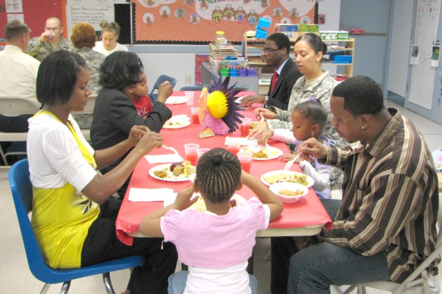 Families share early Thanksgiving meal
