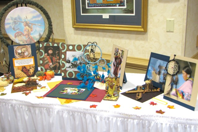 A display of Native American artifacts, including a medicine shield (upper left), dream catcher (center, in blue), musical instrument (right) and artwork allowed attendees to see some of the works produced by these cultures. Besides these items, Native American societies also developed many things used today, such as a constitutional government, equal rights for men and women, sewage systems, artificial soil and bioengineered corn.