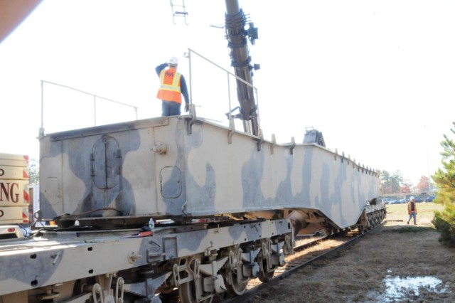 Contract personnel work on on the recently-delivered carriage of Anzio Annie at Fort Lee.