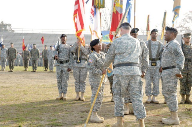 Col. (P) Gwendolyn Bingham, incoming Quartermaster General, accepts the Quartermaster School colors from Maj. Gen. James L. Hodge, Combined Arms Support Command and Sustainment Center of Excellence commanding general during a change of command ceremony Nov. 18.