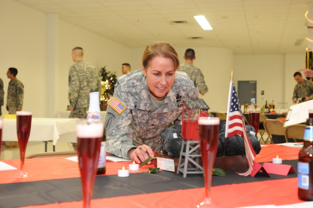 Brig. Gen. Robin B. Akin, judged table decorations during the University of Louisville's Reserve Officer Training Corps dining-in on Nov. 19 at United Auto Workers Post 862 in Louisville, Ky.  The ROTC cadets decorated their tables based on their personalities and hobbies. (U.S. Army photo by Sgt. Michael Behlin)
