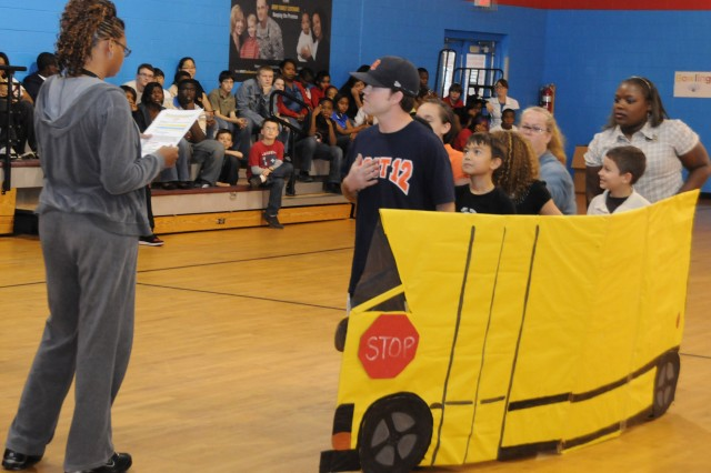 CYSS staff and children worked together on skits as part of the Stop Bullying program during a Military Family Month event at the CYSS gym Nov. 19. Parents and children were also treated to hot dogs, chips and pie afterwards.