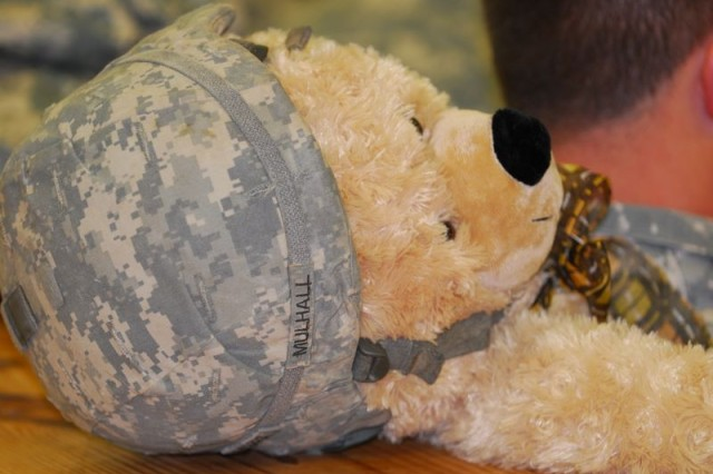 Paratrooper Mulhall waits with his bear for an opportunity to jump at Operation Toy Drop last year. The annual event takes place December 10th and 11th at Fort Bragg and will raise more than 6,000 toys for area families.
