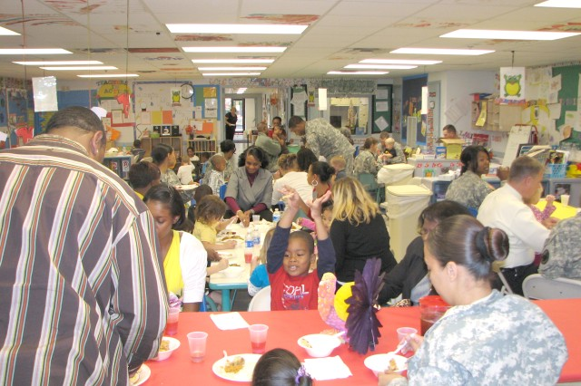 Families enjoy some quality time together at the CYSS pre-kindergarten class luncheon Nov. 17.