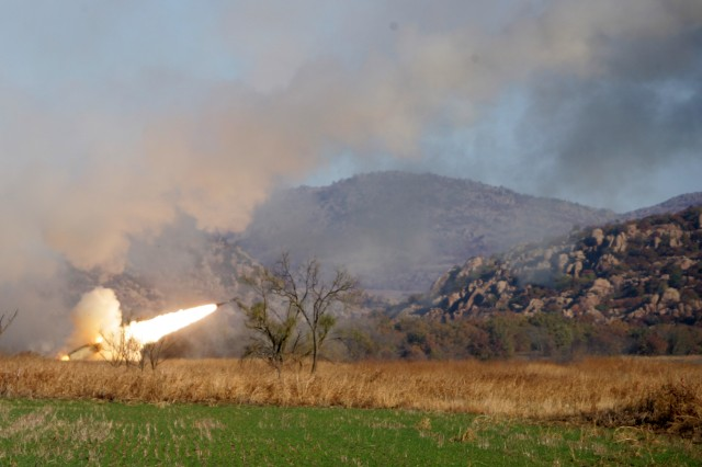 A High Mobility Artillery Rocket System (HIMARS) battery fires a rocket Friday during a live fire exercise consisting of U.S. Army and Marine Corps personnel and members of the Singapore armed forces during Exercise Daring Warrior.