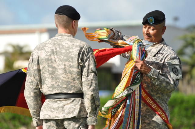 Command Sgt. Maj. Frank M. Leota, command sergeant major, 25th Infantry Division (right) and Maj. Gen. Bernard S. Champoux, commanding general, 25th Inf. Div., prepare the division colors to be cased during the 25th Inf. Div. Deployment Ceremony, held on Schofield Barracks, Hawaii, Nov. 24. The casing of the colors represents symbolizes preparing the unit for deployment and readying the colors for travel. (U.S. Army photo by Sgt. Jesus J. Aranda, 25th Infantry Division Public Affairs Office)