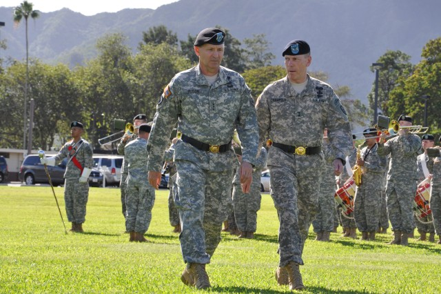Lieutenant Gen. Benjamin R. Mixon, U.S. Army Pacific (left), and Maj. Gen. Bernard S. Champoux, commanding general, 25th Infantry Division, inspect the companies of Headquarters and Headquarters Battalion (HHBN) during the 25th Inf. Div. Deployment Ceremony, held on Schofield Barracks, Hawaii, Nov. 24. The deployment ceremony marks the departure of HHBN and the division headquarters to their fourth deployment since the attacks on 9/11. (U.S. Army photo by Sgt. Jesus J. Aranda, 25th Infantry Division Public Affairs Office)