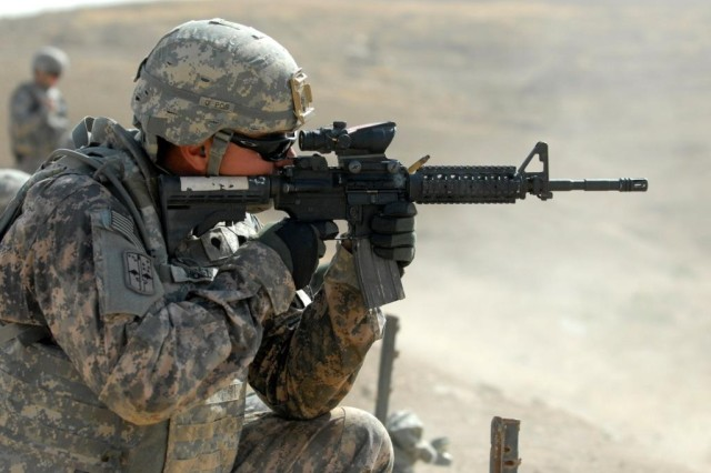 U.S. Army Spc. Francisco Jimenez, an infantryman assigned to Personal Security Detail, 4th Advise and Assist Brigade, 1st Cavalry Division, fires a round from an M4 carbine during marksmanship sustainment training in Mosul, Iraq, Sept. 29, 2010. The M4 Carbine is one of the weapons to which the M855A1 5.56mm Enhanced Performance Round is tailored.