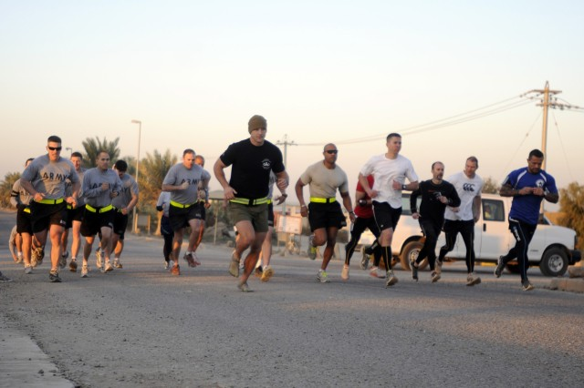 Participants in the Raider Brigade Supports the Wounded Warrior Project Workout/Run begin the 3.5-mile run portion of the competition on Camp Liberty Nov. 21.